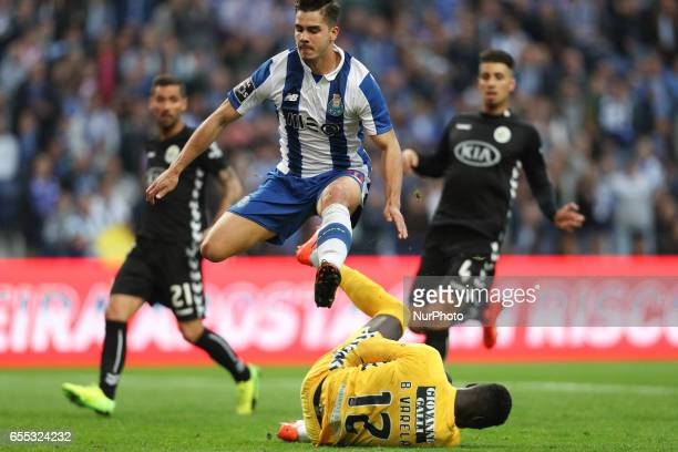 Porto's Portuguese forward Andre Silva vies with Setubals Portuguese goalkeeper Bruno Varela during the Premier League 2016/17 match between FC Porto...