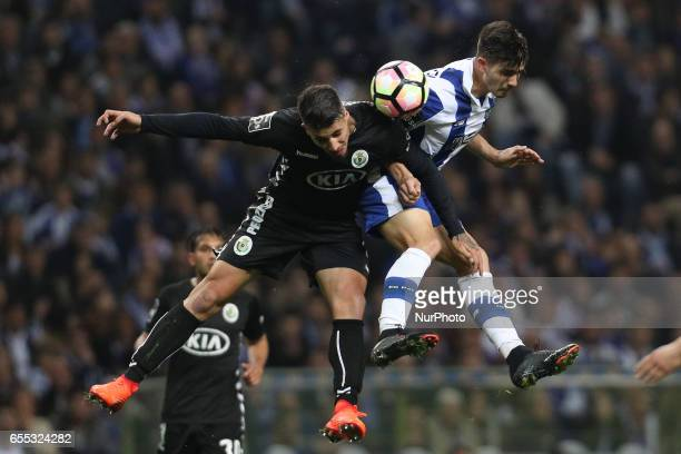 Porto's Portuguese forward Andre Silva vies with Setubals Portuguese defender Fabio Cardoso during the Premier League 2016/17 match between FC Porto...