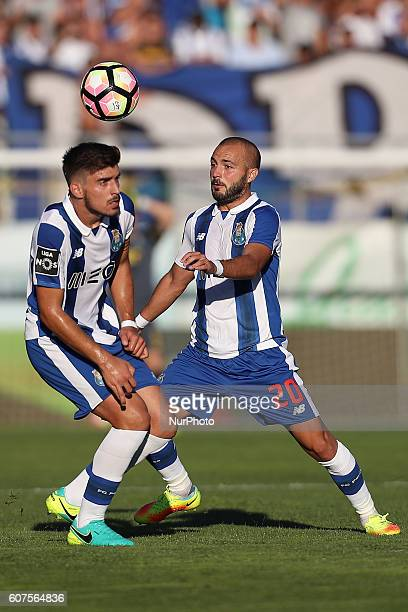 Porto's Portuguese midfielder Andre Andre and Porto's Portuguese midfielder Ruben Neves during Premier League 2016/17 match between CD Tondela and FC...