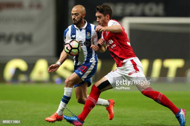 Porto's Portuguese midfielder Andre Andre in action with Braga's Serbian midfielder Nikola Vukcevic during the Premier League 2016/17 match between...