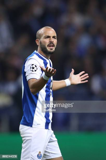 Porto's Portuguese midfielder Andre Andre reacts during the UEFA Champions League Group G match between FC Porto and RB Leipzig at Dragao Stadium on...