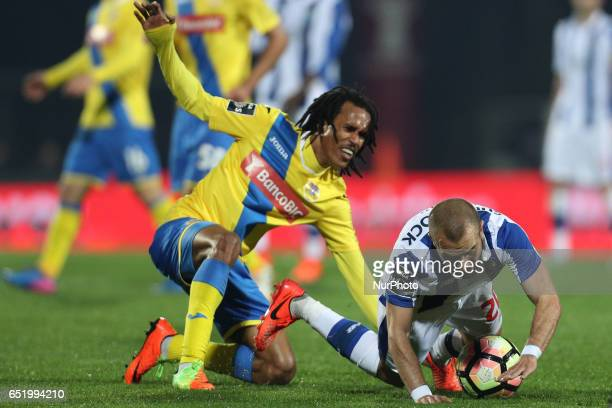 Porto's Portuguese midfielder Andre Andre vies with Arouca's forward Kuca during Premier League 2016/17 match between FC Arouca and FC Porto at...