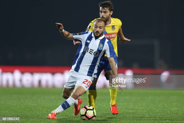 Porto's Portuguese midfielder Andre Andre vies with Arouca's Portuguese midfielder Andre Santos during Premier League 2016/17 match between FC Arouca...