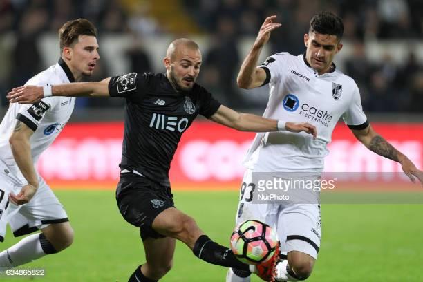 Porto's Portuguese midfielder Andre Andre vies with Vitoria SC's Colombian midfielder Guillermo Celis and Vitoria SC's Portuguese defender Josue Sa...