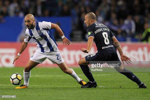 Porto's Portuguese midfielder Andre Andre with Belenenses´s Portuguese midfielder Andre Sousa during the Premier League 2017/18 match between FC...