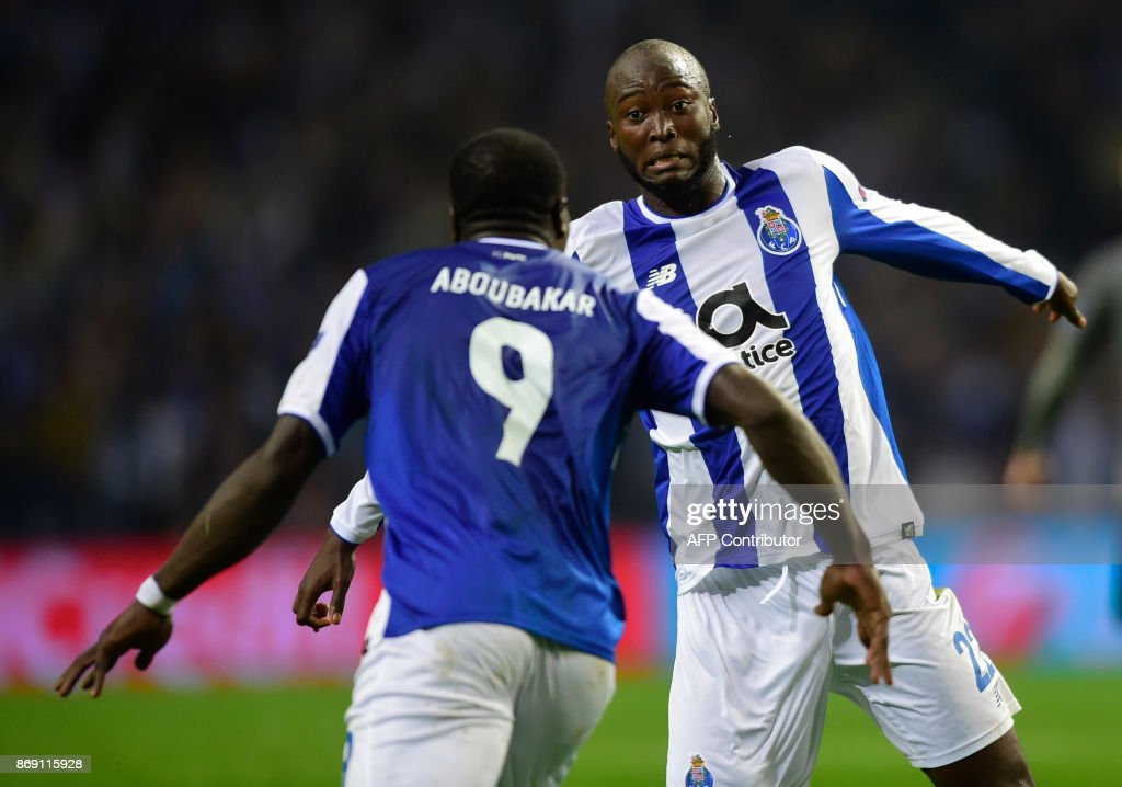Porto's Portuguese midfielder Danilo Pereira (R) celebrates with Cameroonian forward Vincent Aboubakar after scoring a goal during the UEFA Champions League group G football match FC Porto vs Leipzig at Dragao stadium in Porto on November 1, 2017. /