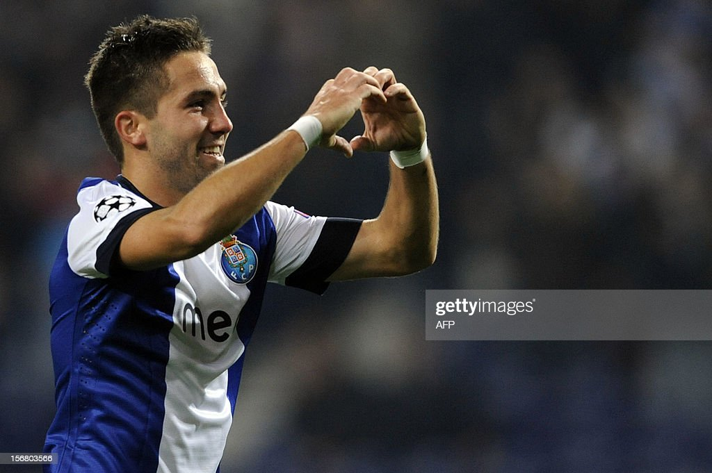 FC Porto's Portuguese midfielder Joao Moutinho (R) celebrates after scoring during the UEFA Champions League group A football match FC Porto against GNK Dinamo Zagreb on November 21, 2012, at Dragao Stadium in Porto.