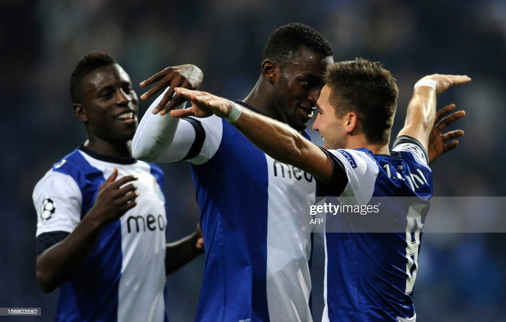 FC Porto's Portuguese midfielder Joao Moutinho (R) celebrates with teammates forward Silvestre Varela (L) and Colombian forward Jackson Martínez (C) after scoring during the UEFA Champions League group A football match FC Porto against GNK Dinamo Zagreb on November 21, 2012, at Dragao Stadium in Porto.