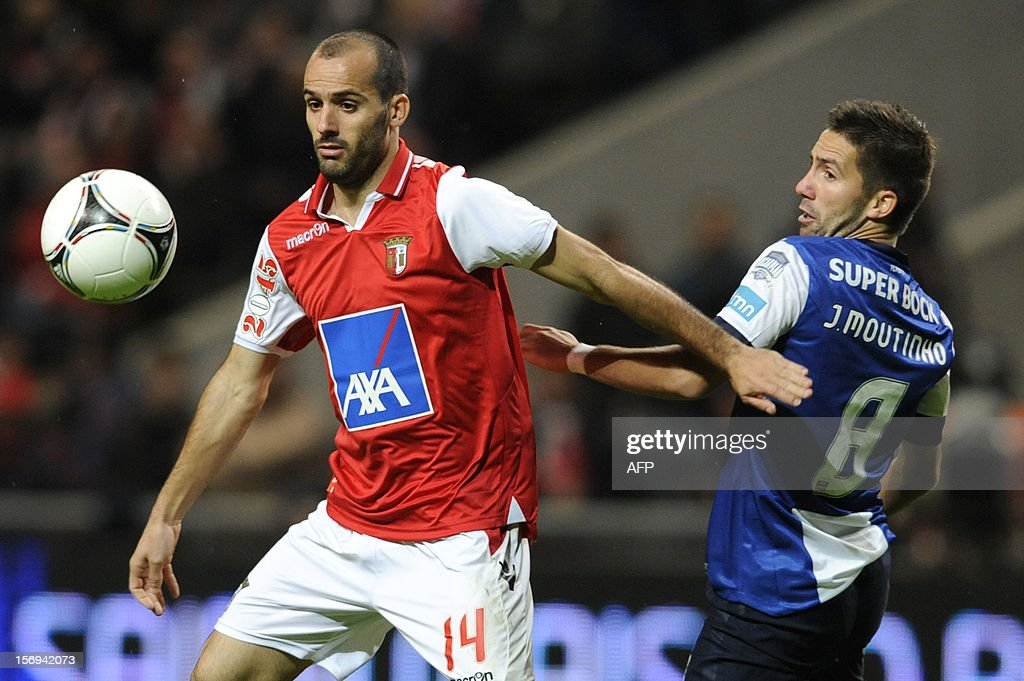 FC Porto's Portuguese midfielder Joao Moutinho (R) vies with Braga's Portuguese midfielder Ruben Micael during the Portuguese League football match Braga vs Porto, on November 25, 2012, at Axa Municipal Stadium in Braga.