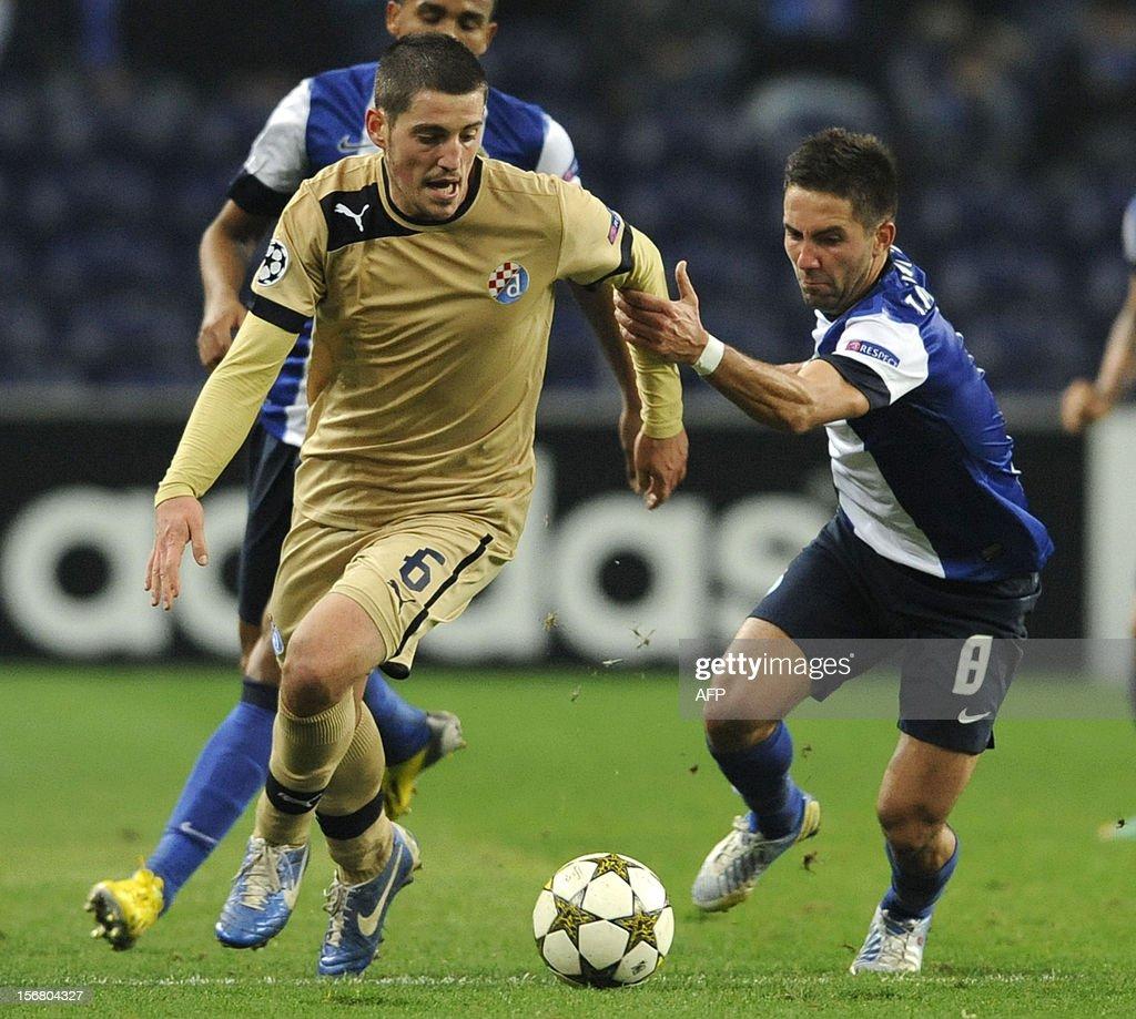 FC Porto s Portuguese midfielder Joao Moutinho R vies with GNK