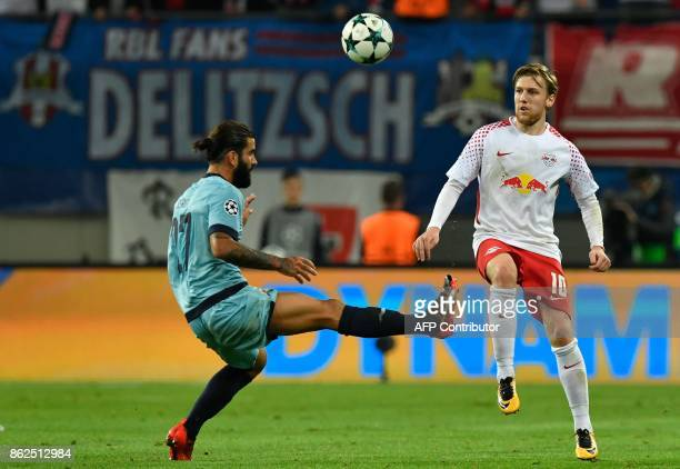 Porto's Portuguese midfielder Sergio Oliveira and Leipzig's Swedish midfielder Emil Forsberg vie for the ball during the UEFA Champions League group...