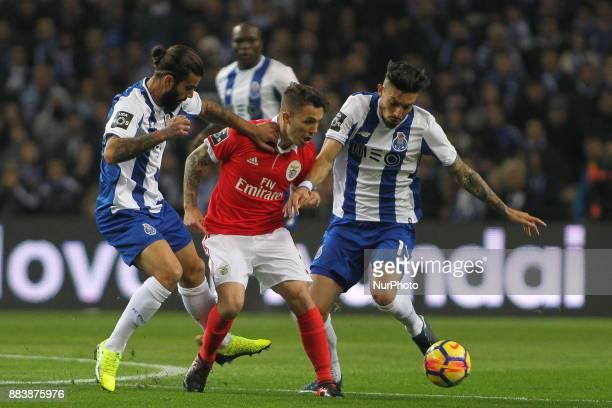 Porto's Portuguese midfielder Sergio Oliveira with Benfica's Spanish defender Alex Grimaldo and Porto's Brazilian defender Alex Telles during the...