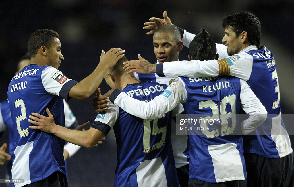 Porto's Russian midfielder Marat Izmaylov (C) is congratulated by teammates after scoring a goal during the Portuguese league football match FC Porto vs Pacos Ferreira at the Dragao stadium in Porto on January 19, 2013.