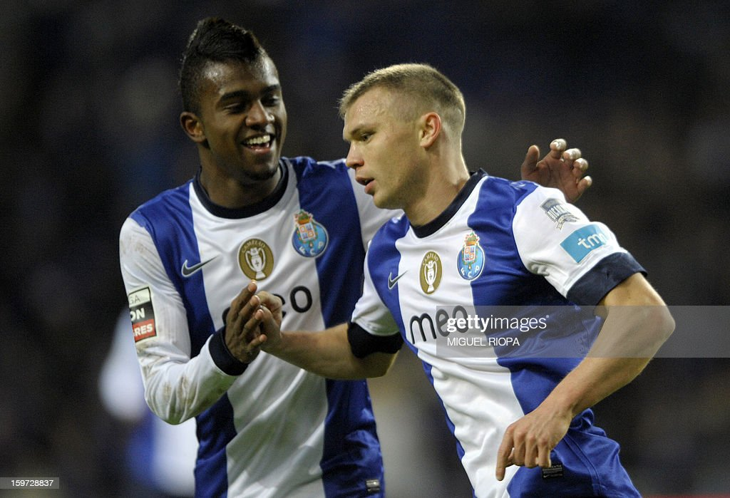 Porto's Russian midfielder Marat Izmaylov (R) is congratulated by teammate Brazilian midfielder Kelvin Oliveira after scoring a goal during the Portuguese league football match FC Porto vs Pacos Ferreira at the Dragao stadium in Porto on January 19, 2013.