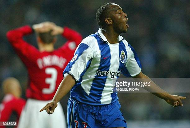 Porto's South African Benny McCarthy celebrates after scoring first goal against Manchester United during the champions league football match at...