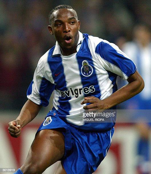 Porto's South African Benny McCarthy celebrates after scoring the first goal against Manchester United during the champions league football match at...