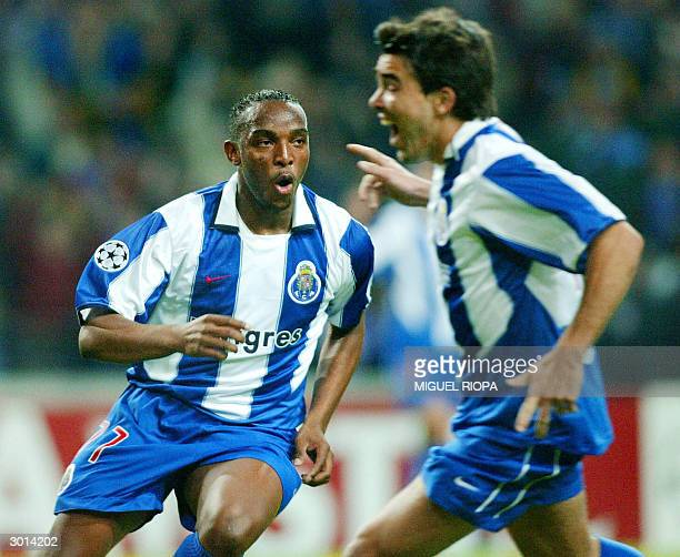 Porto's South African Benny McCarthy celebrates with teammate Anderson De Souza Deco after scoring the first goal against Manchester United during...