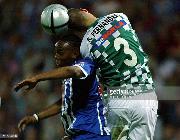 Porto's South African Benny McCarthy vies with Moreirense FC 's Ricardo Fernandes during their Portuguese superleague football match at Comendador...