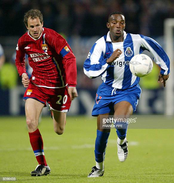 Porto's South African forward Benni McCarthy vies with Lyon's Swiss defender Patrick Mller during their Champions League quarterfinal second leg...
