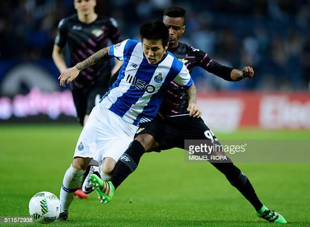 Porto's South Korean forward Suk Hyunjun vies with Moreirense's French defender Pierre Sagna during the Portuguese league football match FC Porto vs...