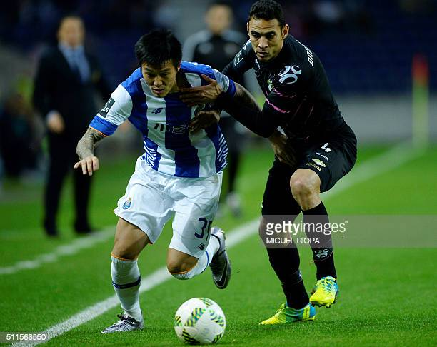 Porto's South Korean forward Suk Hyunjun vies with Moreirense's Brazilian defender Danielson during the Portuguese league football match FC Porto vs...