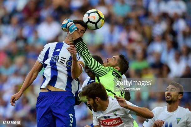 Porto's Spanish defender Ivan Marcano heads the ball beside Estoril's goalkeeper Moreira during the Portuguese league football match FC Porto vs...