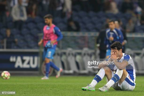 Porto's Spanish defender Ivan Marcano sits on the pitch at the end of the Portuguese league football match FC Porto vs CD Feirense at the Dragao...