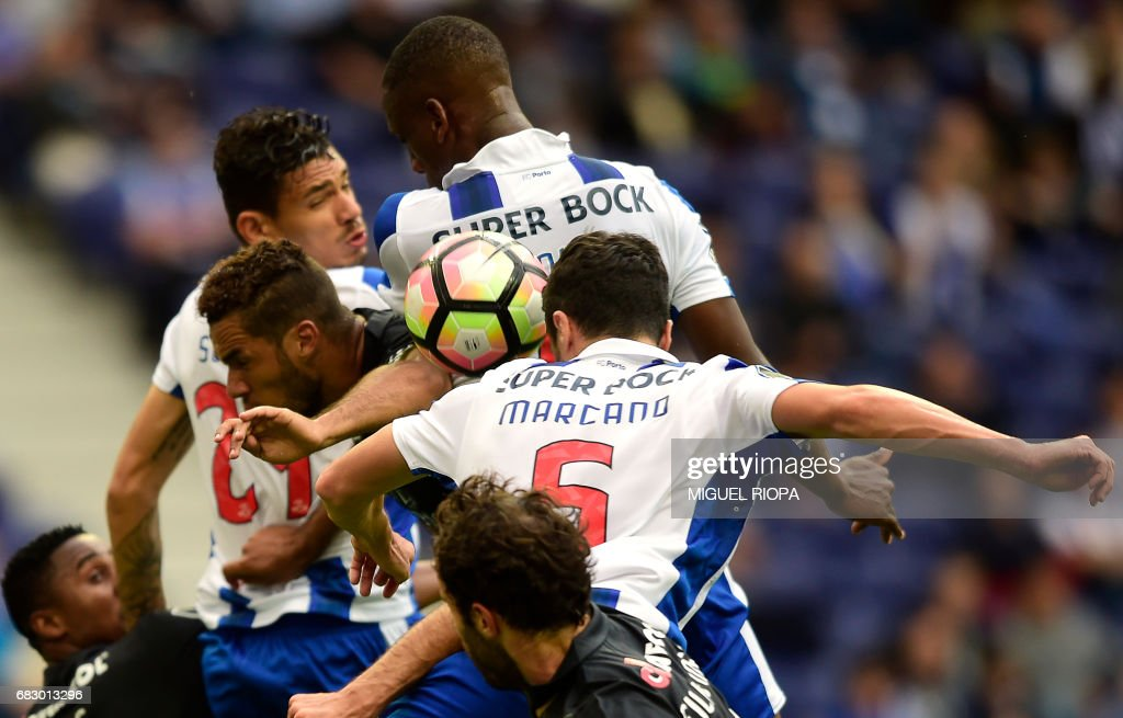 Porto's Spanish defender Ivan Marcano (R) tries to head the ball during the Portuguese league football match FC Porto vs FC Pacos de Ferreira at the Dragao stadium in Porto on May 14, 2017. /