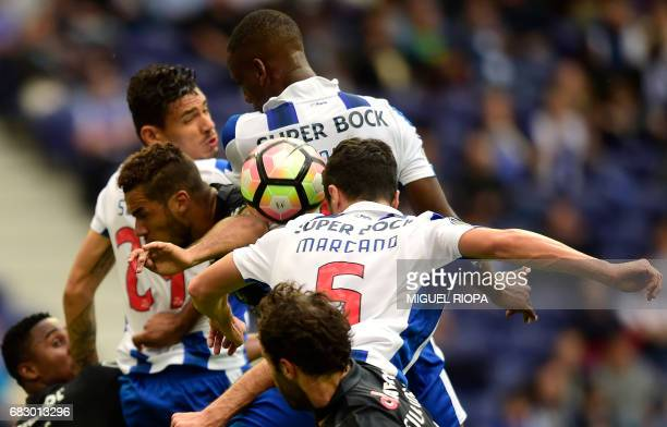 Porto's Spanish defender Ivan Marcano tries to head the ball during the Portuguese league football match FC Porto vs FC Pacos de Ferreira at the...