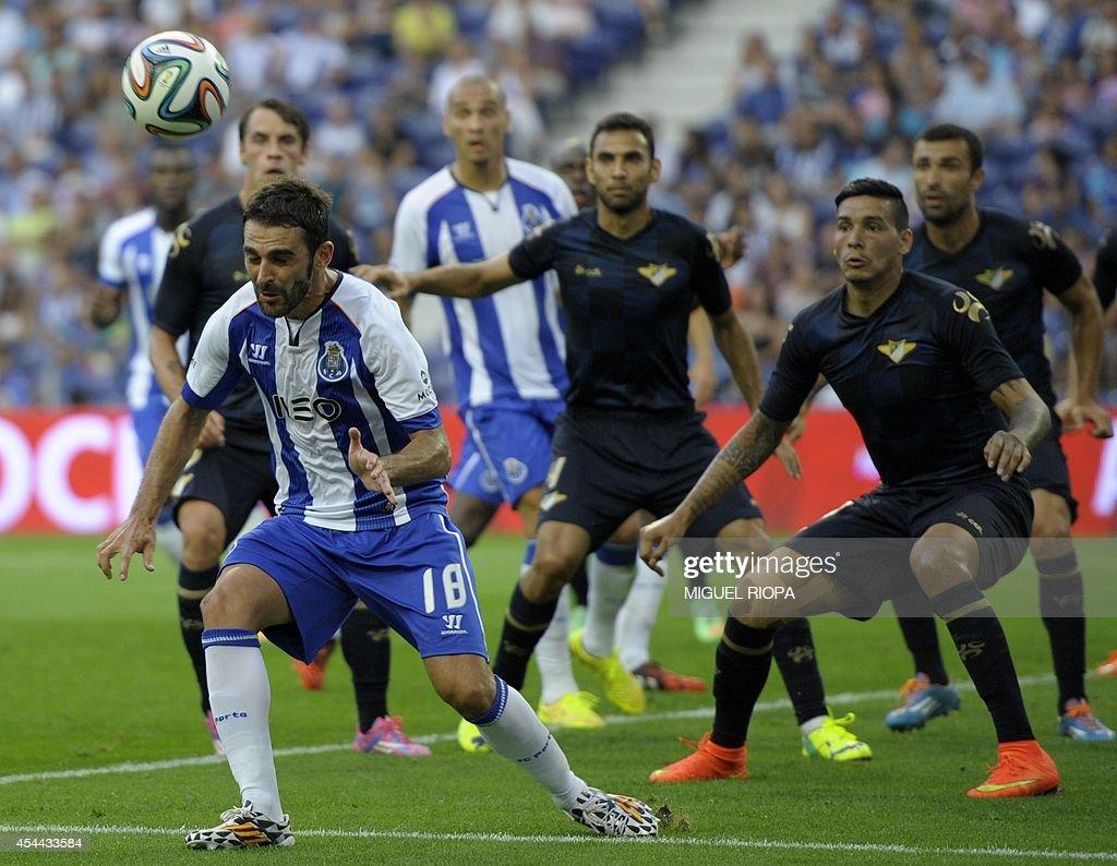 Porto's Spanish forward Adrian Lopez (L) heads the ball during the Portuguese league football match FC Porto vs Moreirense at the Dragao Stadium in Porto, on August 31, 2014. Porto won the match 3-0.