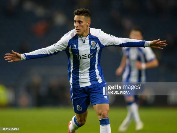 Porto's Spanish forward Cristian Tello celebrates with teammates after scoring a goal during the Portuguese league football match FC Porto v FC Pacos...
