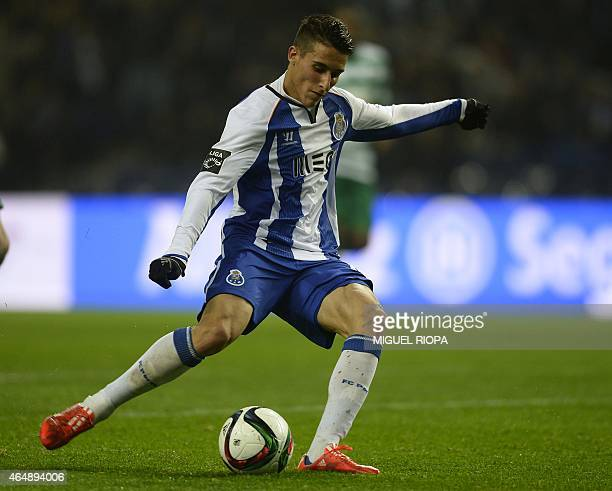 Porto's Spanish forward Cristian Tello kicks the ball to score his second goal during the Portuguese league football match FC Porto vs Sporting CP at...