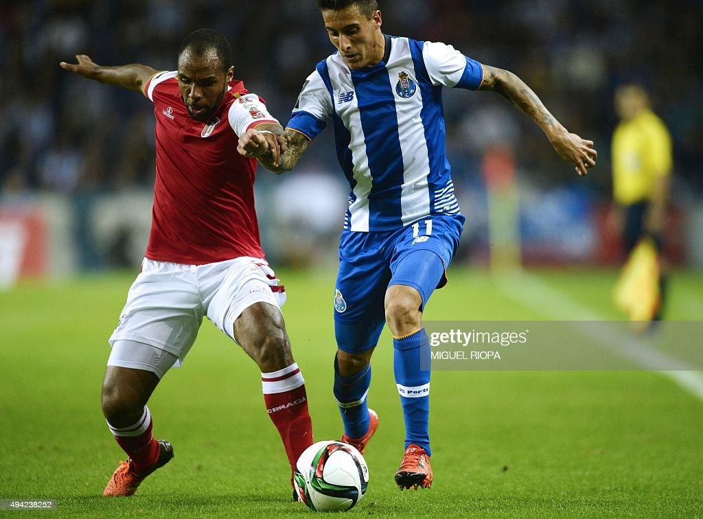 Porto's Spanish forward Tello vies with Sporting Braga's Brazilian defender Baiano during the Portuguese league football match FC Porto v SC Braga at...
