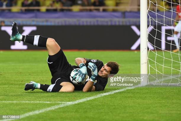 Porto's Spanish goalkeeper Iker Casillas catches the ball during the UEFA Champions League Group G football match AS Monaco FC vs FC Porto on...