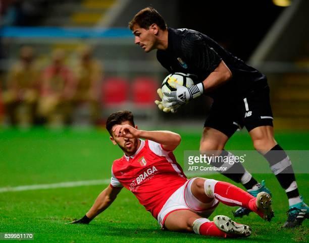 Porto's Spanish goalkeeper Iker Casillas catches the ball next to Sporting Braga's forward Paulinho during the Portuguese league football match...