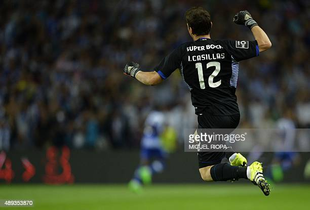 Porto's Spanish goalkeeper Iker Casillas celebrates the goal scored by his teammate midfielder Andre Andre during the Portuguese league football...