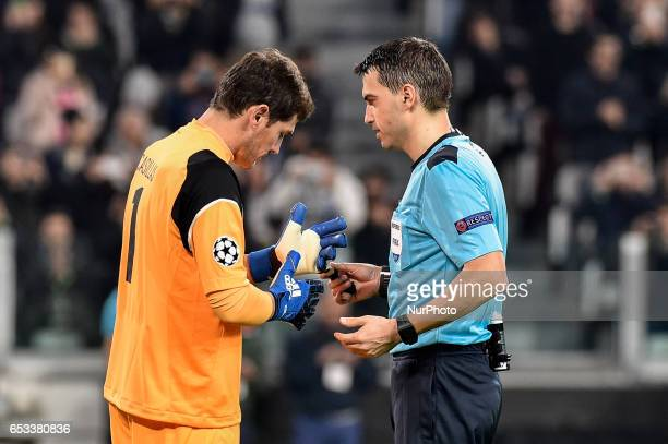 Porto's Spanish goalkeeper Iker Casillas discusses with the referee during the UEFA Champions League Round of 16 2st leg soccer match between...
