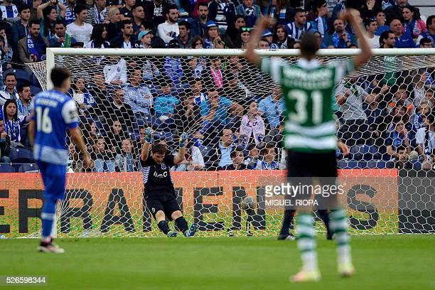 Porto's Spanish goalkeeper Iker Casillas grabs the goal's net after Sporting CP's 3rd goal during the Portuguese league football match FC Porto vs...