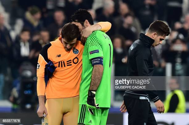 Porto's Spanish goalkeeper Iker Casillas is comforted by Juventus' goalkeeper from Italy Gianluigi Buffon at the end of the UEFA Champions League...