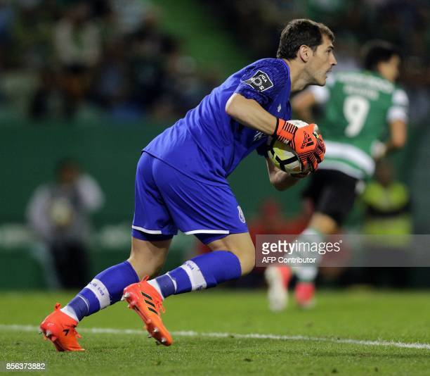 Porto's Spanish goalkeeper Iker Casillas makes a save during the Portuguese league football match Sporting CP vs FC Porto at the Alvalade stadium in...