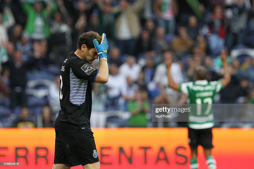 Porto's Spanish goalkeeper Iker Casillas reacts after soffers a goal during the Premier League 2015/16 match between FC Porto and Sporting CP, at Drag��o Stadium in Porto on April 30, 2016.