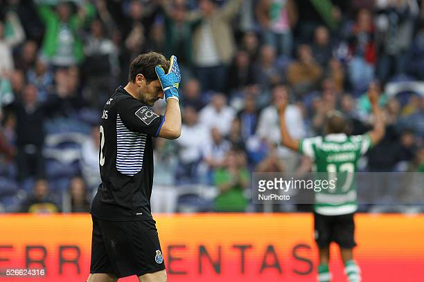 Porto's Spanish goalkeeper Iker Casillas reacts after soffers a goal during the Premier League 2015/16 match between FC Porto and Sporting CP at...