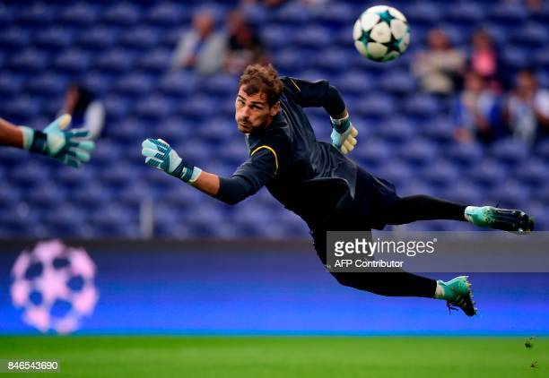 Porto's Spanish goalkeeper Iker Casillas warms up before the UEFA Champions League football match FC Porto vs Beskitas JK at the Dragao stadium in...