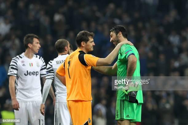 Porto's Spanish goalkeeper Iker Casillas with Gianluigi Buffon goalkeeper of Juventus FC during the UEFA Champions League Round of 16 1st leg soccer...