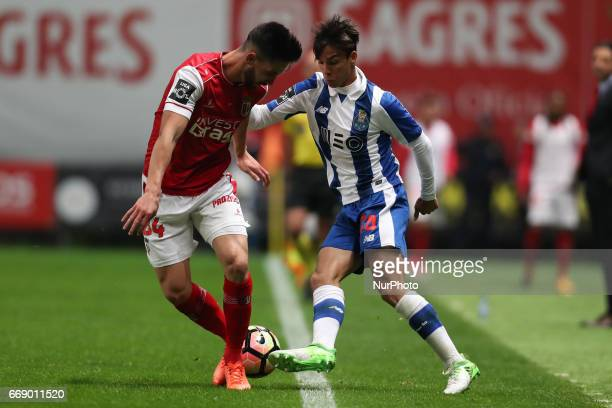 Porto's Spanish midfielder Oliver Torres in action with Braga's midfielder Gamboa during the Premier League 2016/17 match between SC Braga and FC...