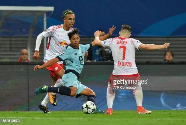 Porto's Spanish midfielder Oliver Torres is pressured on the ball by Leipzig's Austrian midfielder Marcel Sabitzer and Leipzig's Danish forward...