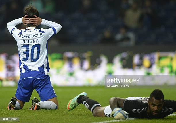 Porto's Spanish midfielder Oliver Torres reacts after missing a goal opportunity next to Setubal's goalkeeper Ricardo Batista during the Portuguese...