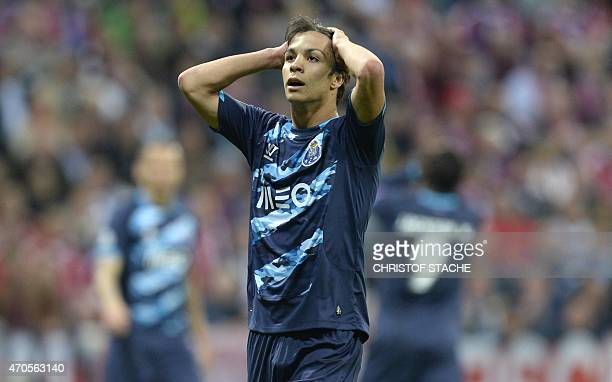 Porto's Spanish midfielder Oliver Torres reacts after the UEFA Champions League secondleg quarterfinal football match Bayern Munich v FC Porto in...
