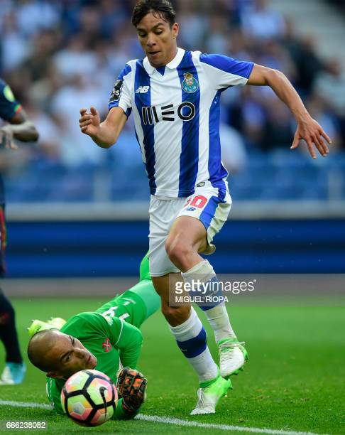Porto's Spanish midfielder Oliver Torres tries to score a goal next to Belenenses' goalkeeper Cristiano Figueiredo during the Portuguese league...