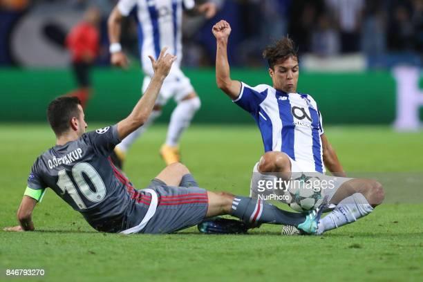 Porto's Spanish midfielder Oliver Torres vies with Besiktas' midfielder Oguzhan Ozyakup during the FC Porto v Besiktas UEFA Champions League Group G...